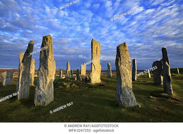 The Neolithic Stone Circle at Callanish on the Isle of Lewis bathed in late afternoon light in October