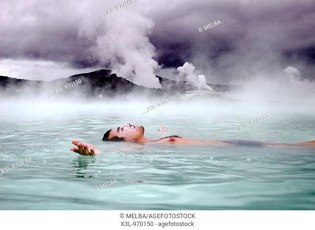 Young man in Blue Lagoon Geothermal Spa  Grindavík  Iceland