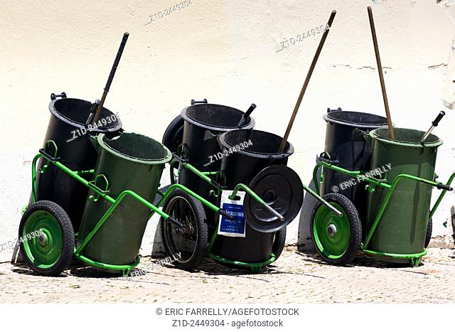 Street cleaners bins. Lisbon Portugal