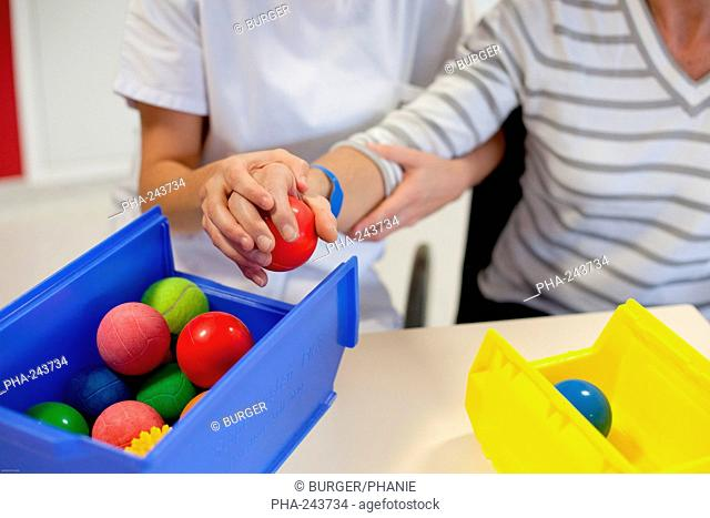 Functional rehabilitation of a hemiplegic woman. Occupational therapy session. Department of Physical Medicine and Rehabilitation, Limoges hospital, France