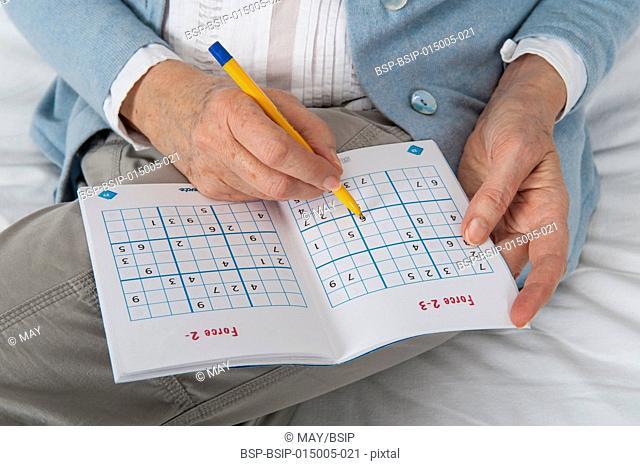 Senior woman playing sudoku