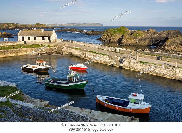 Early morning over the tiny harbor at Ballintoy, County Antrim, Northern Ireland, UK