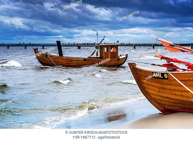 Two Fishing boats at the beach of the Baltic Sea, near the pier of the Baltic Sea resort of Ahlbeck, Municipality of Heringsdorf, Usedom Island