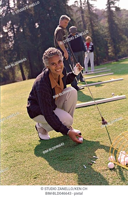 Senior African American woman playing golf