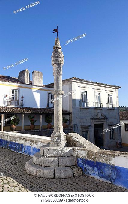 Óbidos, Portugal: Medieval pillory at Praça de Santa Maria in the old village