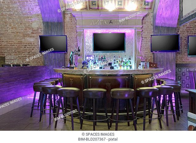 Neon lights illuminating empty bar