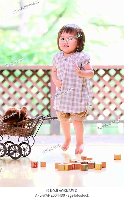 Mixed-race young girl with teddy bear