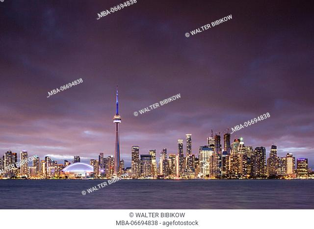 Canada, Ontario, Toronto, Harbourfront, CN Tower, Rogers Centre, and skyline from Olympic Island, dusk
