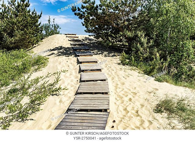 Steps to the up to 60 meter high dune in Nida. Nida (Nidden) is a village on the Curonian Spit to the Baltic Sea. The village is located on the lagoon side of...