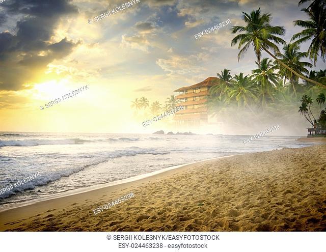 Morning fog over sandy beach of the ocean