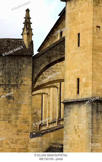 Flying buttresses made of sandstone on Saint-Sacerdos Cathedral in Sarlat, Dordogne region of France