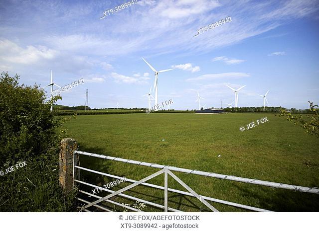 wind turbines on farmland in the lake district near whitehaven Cumbria England UK