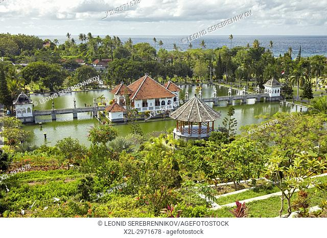 Gili Bale, main building of the Ujung Water Palace (Taman Ujung), surrounded by water and landscaped garden. Karangasem Regency, Bali, Indonesia