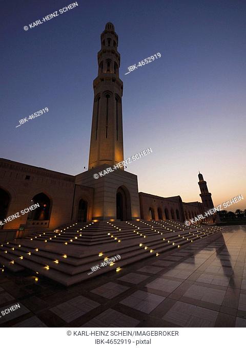 Evening atmosphere, illuminated Great Sultan Qabus Mosque and Minaret, Muscat, Oman