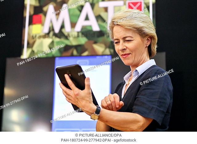 24 July 2018, Germany, Leipzig: German Minister of Defence Ursula von der Leyen of the Christian Democratic Union (CDU) holds a tablet in her hands during her...