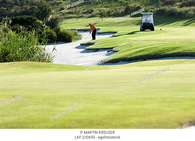 A man playing golf on the golf course of the Arabella Western Cape Hotel & Spa, Hermanus, Western Cape, South Africa, Africa