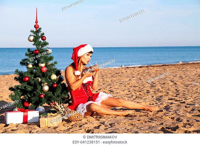 girl Christmas costume Christmas tree in the South on the beach