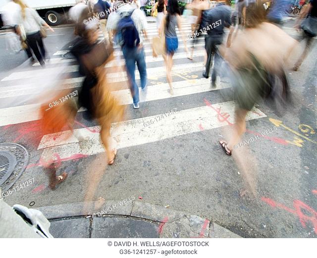 Pedestrians in crosswalk in New York, New York, USA