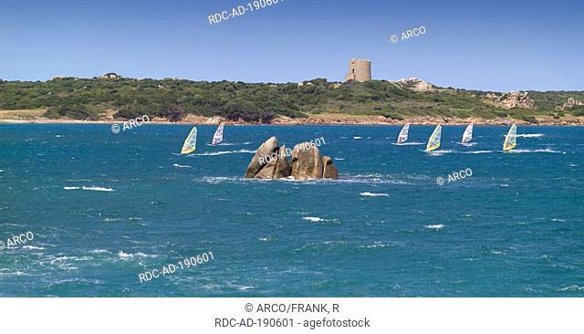 Surfer, view on Aragonese Tower, Vignola Mare, Gallura, Sardinia, Italy, Mediterranean Sea