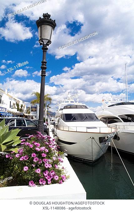 Harbour PUERTO BANUS SPAIN Luxury yachts at marina jetty harbor and flowers