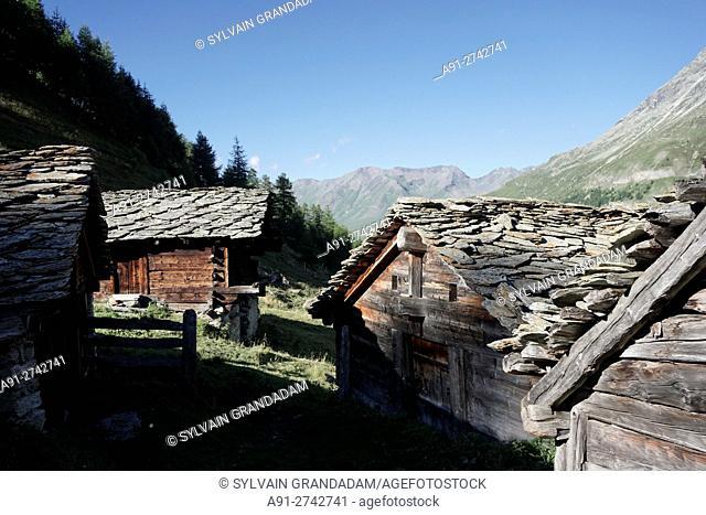 "Switzerland, Valais, Val d'Herens, village of Evolene in summer, the La Gouille hamlet """"mayens"""" near Blue Lake"