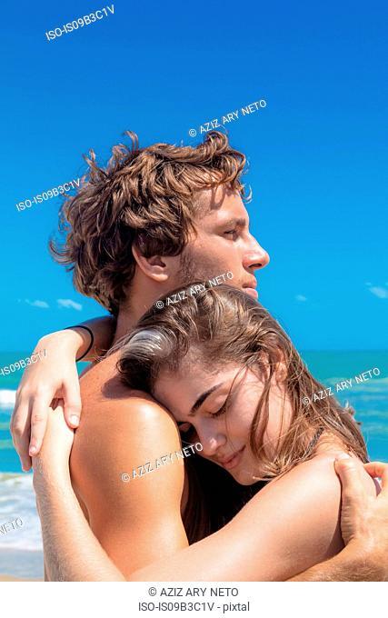 Young couple hugging on beach, Taiba, Ceara, Brazil