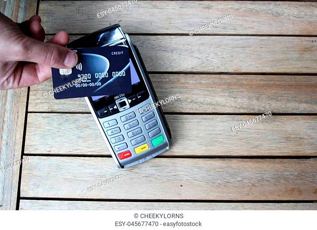contactless payment card pdq background copy space with hand holding credit card ready to pay