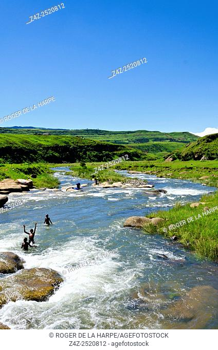 Young boys swimming in Mhlwazini River near the Cathedral Peak region of the Ukhahlamba Drakensberg Park. KwaZulu Natal. South Africa