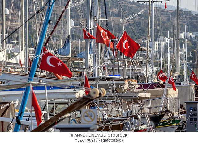 Turkish flags on boats in Bodrum harbour, Turkey