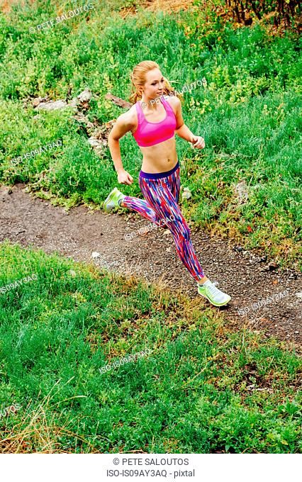 High angle view of teenage female runner running in park