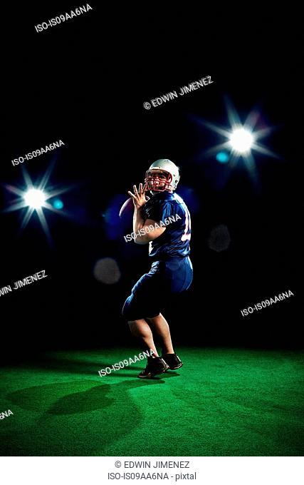 American footballer throwing ball