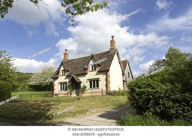 Attractive detached house built from chalk stone in village of Compton Bassett, Wiltshire, England, UK