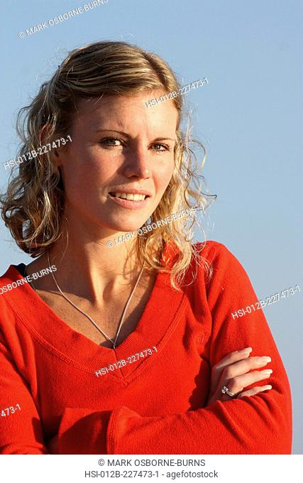 Portrait of young blonde woman outdoors at the beach