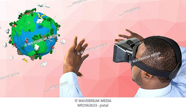 Businessman wearing VR glasses while gesturing by low poly earth