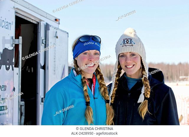 Twins Anna and Kristy Berington pose for a picture before starting the Iditarod Sled dog race at the restart in Willow Alaska in 2014
