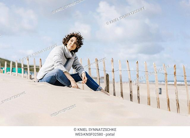 Woman sitting on the beach
