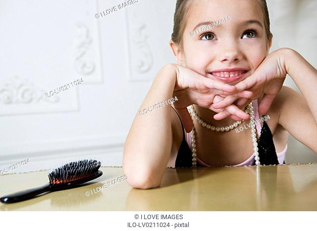 Young girl playing at dressing up