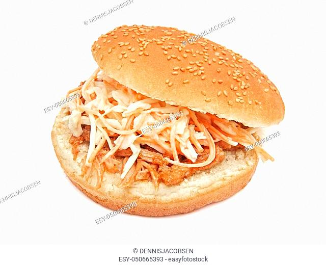 Pulled pork and coleslaw burger isolated on a white background
