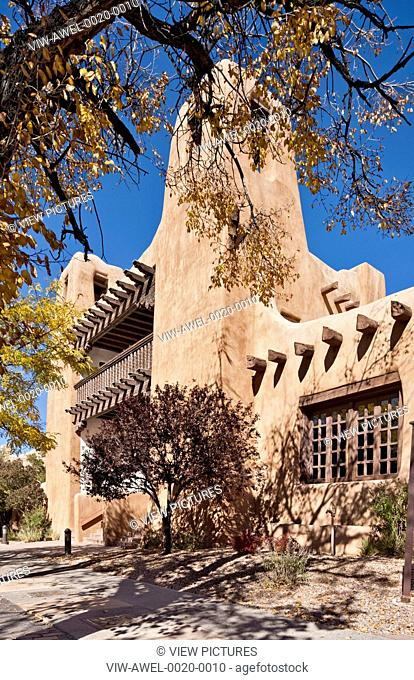 New Mexico Museum of Art, Santa Fe, United States. Architect: Isaac Hamilton Rapp, 1917. Exterior elevation with trees framing building