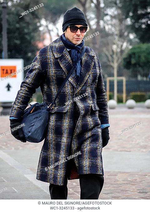 FLORENCE, Italy- January 8 2019: Men on the street during the Pitti 95