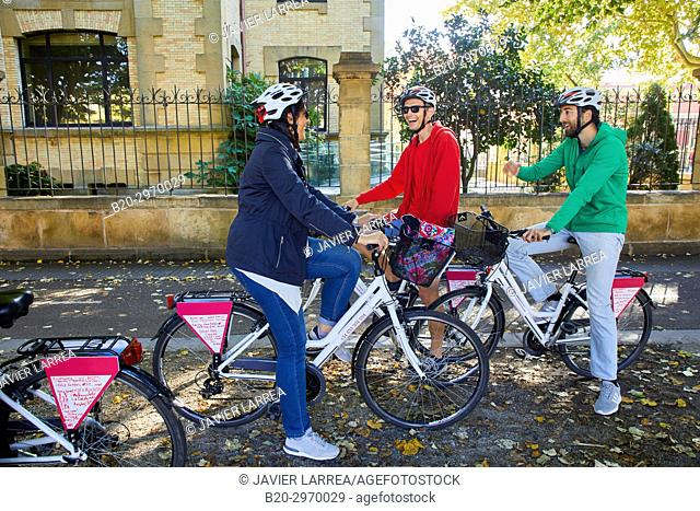 Group of tourists and guide making a bicycle tour through the city, Donostia, San Sebastian, Gipuzkoa, Basque Country, Spain, Europe
