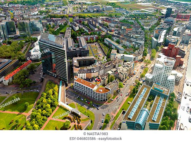 High top view of city office buildings from Dusseldorf Rhine Tower in summer sunny day. Germany