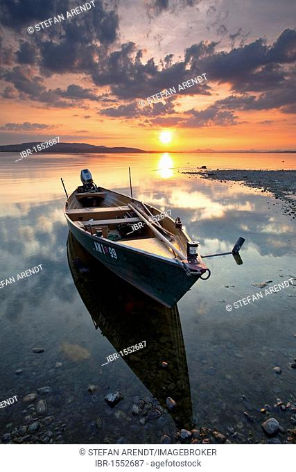 Fishing boat on Lake Constance at dusk with reflections, Reichenau, Baden-Wuerttemberg, Germany, Europe