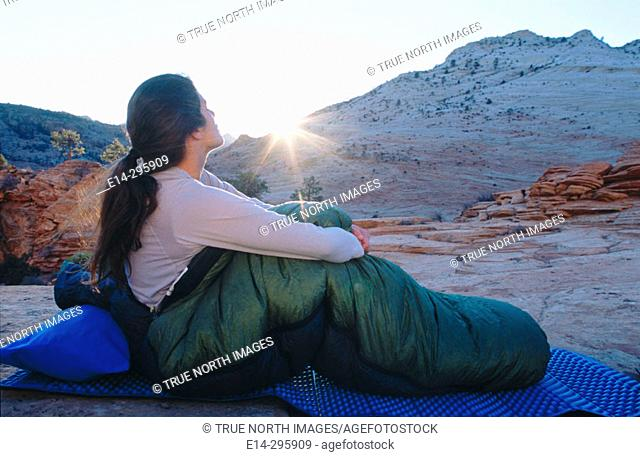 Woman waking up with sunrise at Zion National Park. Utah, USA