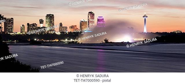 Niagara Falls and Toronto skyline in background