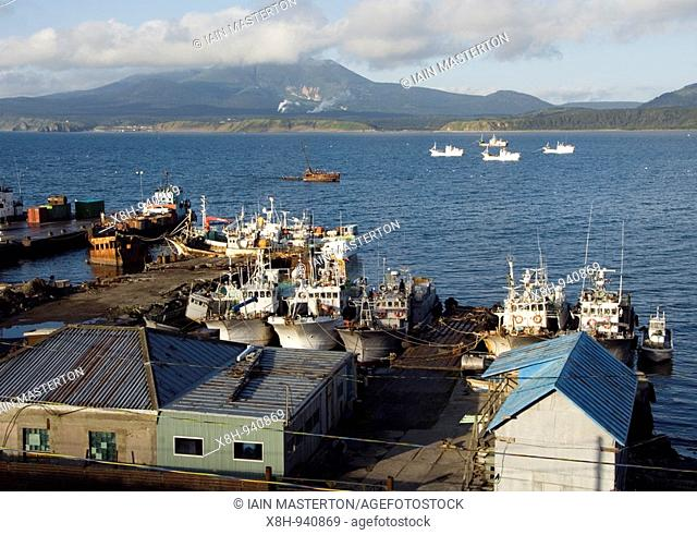 Fishing boats moored in the harbour at Yuzhno-Kurisk on Kunashir Island in the Kuril Island chain in Russia