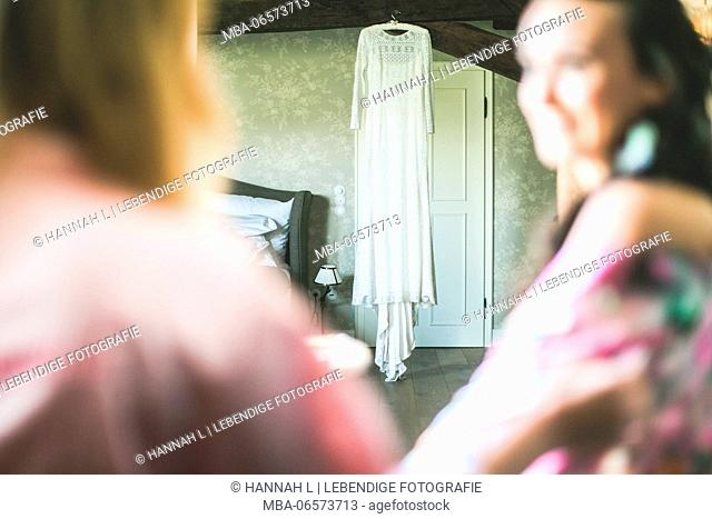 Bride and girlfriend at wedding preparations, detail