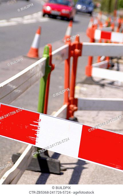 Barrier at road works, close up, UK