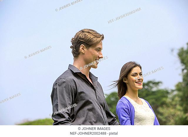 Smiling couple together, low angle view