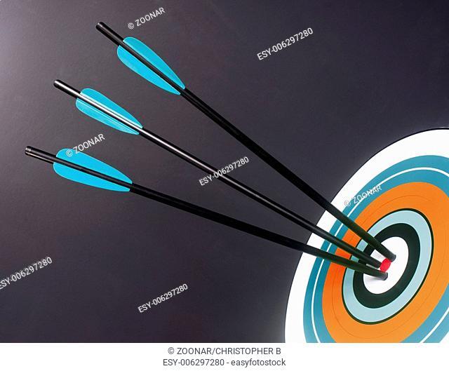 Three Blue Black Archery Arrows Hit Round Target Bullseye Center